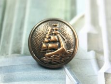 Antique finish metal button