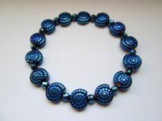 Hematit csiga alakú gyöngy - nebula kék faragott - 12 mm