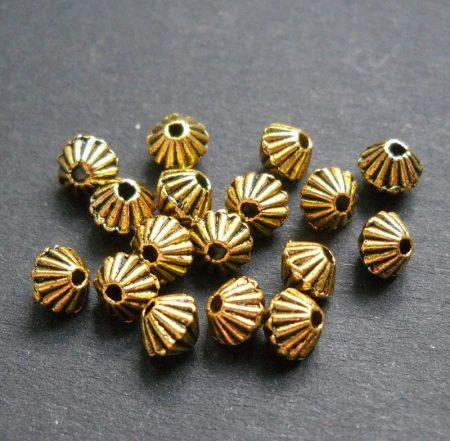 Fémgyöngy - antik arany - 5 mm