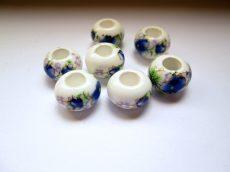 Porcelán gyöngy -  kék virág mintával - 14x10 mm